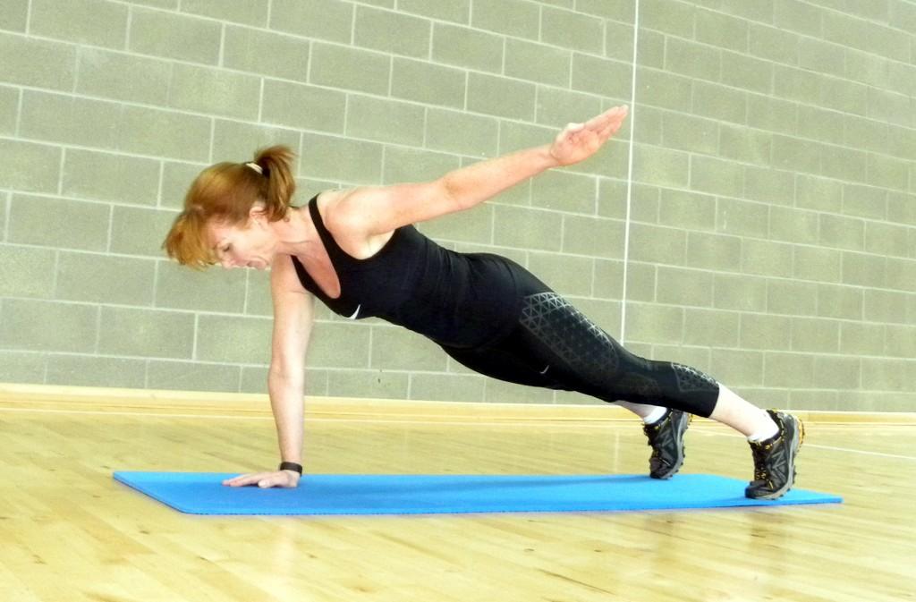 plank with arm raise