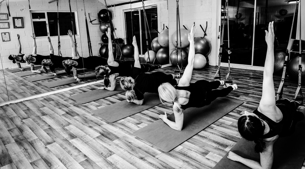 Side Plank - Group TRX Session at The Lair